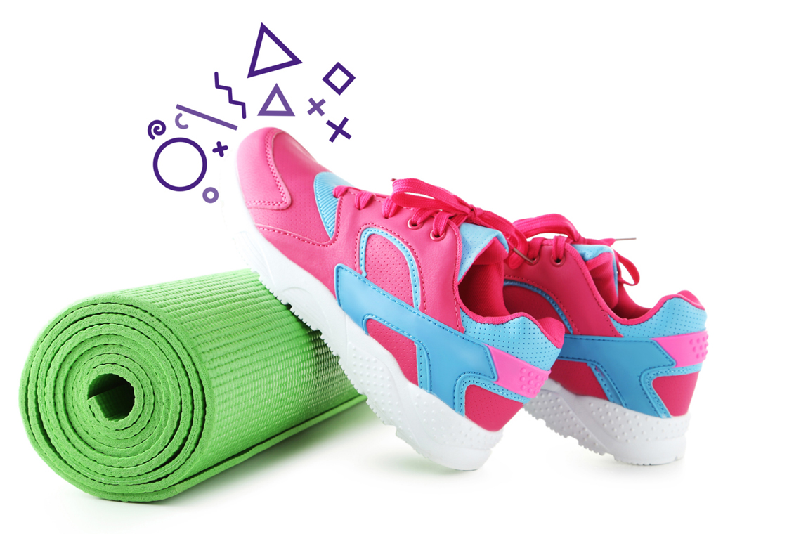 Sneakers on a yoga mat